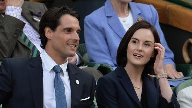 Michelle Dockery and John Dineen at Wimbledon in 2014.