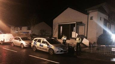 Scene: Police outside house in Larkhall where OAP was allegedly attacked.