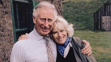Charles and Camilla share a hug while on holiday in Scotland.