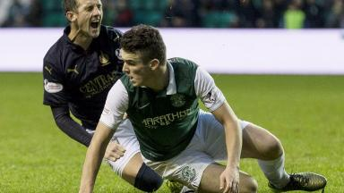 Off: John McGinn got a straight red card for this challenge on Mark Kerr