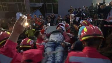 Tian Zeming is carried away from the scene on a stretcher.