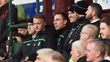 Celtic's leigh Griffiths watches on from the stands.