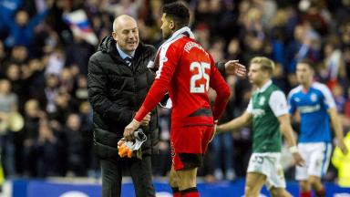 Rangers Manager Mark Warburton (left) shakes hands with Wes Foderingham.