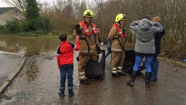 Ellon: Child high-fives firefighter in Aberdeenshire.