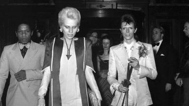 """1973: David Bowie married his first wife Angie in 1970. Here they arrive at Bowie's legendary """"Last Supper"""" party to say farewell to 'Ziggy Stardust and the Spiders From Mars' who gave their last ever show the night before."""