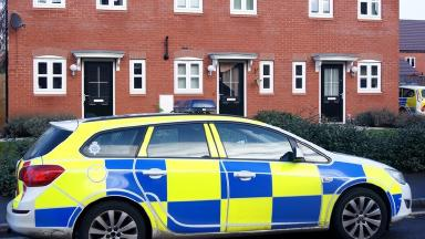 Police outside the property in Burton-on-Trent.