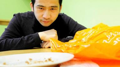 Andrew Cao was disgusted to find a maggot in the biscuits he bought