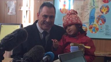 Rob Lawrie (L) with four-year-old Bahar during a press conference before today's hearing.