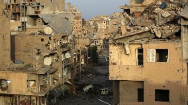 Damaged buildings in Deir al-Zor, eastern Syria.
