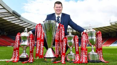 SPFL chief executive Neil Doncaster with the league trophies