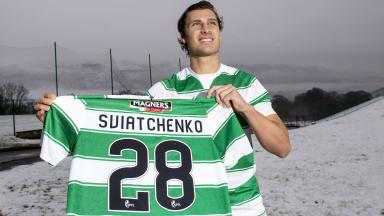 Erik Sviatchenko is all smiles as he is unveiled at Celtic's training ground.