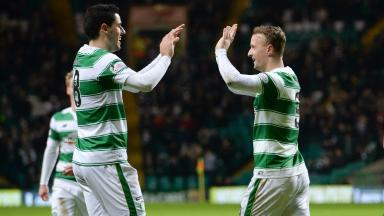 Hamilton hammered: Tom Rogic celebrates with hat-trick hero Leigh Griffiths.