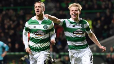 Celebrate: Leigh Griffiths and Gary Mackay-Steven enjoy Celtic's victory.