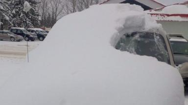 An 80-year-old was charged after driving in a car still covered in thick snow.