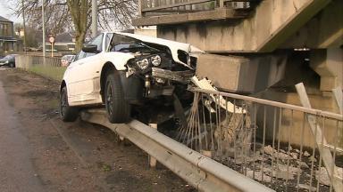 Crash: The car mounted a safety railing.