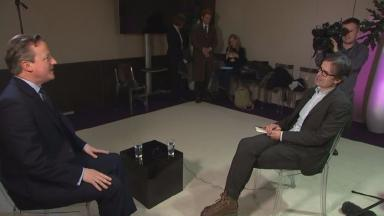 David Cameron and Robert Peston in Davos