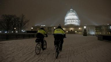 U.S. Capitol police officers patrol on bicycles near the White House