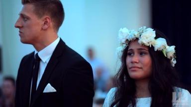 The groom and bride at the start of the Haka