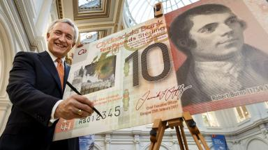 Clydesdale Bank boss David Duffy signs first £10 plastic banknote. Uploaded January 22 2016.