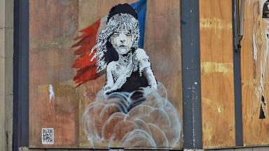 Banksy used the iconic image of a young Claudette from Les Misérables in an attack on the French authorities