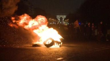 Burning tyres block the road in Paris