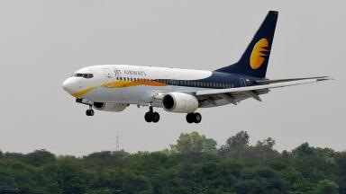 The man opened the door on a Jet Airways plane after it had landed in Mumbai.