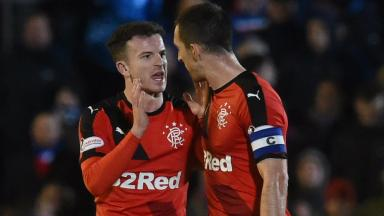 Rangers' Andy Halliday (left) explains the situation to Lee Wallace after being shown a red card