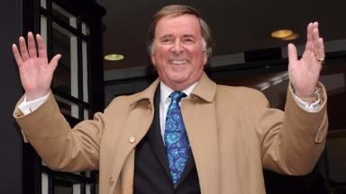 Loved: Sir Terry hosted the Eurovision Song Contest for decades.