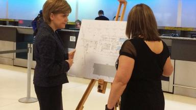 Airport revamp: Nicola Sturgeon views plans in Aberdeen.