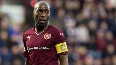 Done deal: Morgaro Gomis has swapped Hearts for Fir Park.
