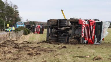Road crash: Firefighters injured when engines crashed off road.