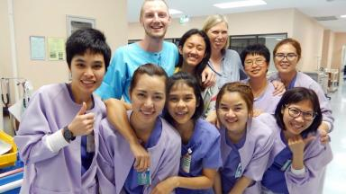 Back home: Owen with girlfriend Janjira (back row middle) and nurses.
