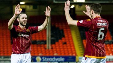 Celebration: James McFadden (left) and Stephen McManus mark the victory.