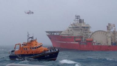 Rescue operation: RNLI lifeboat and coastguard helicopter at the scene