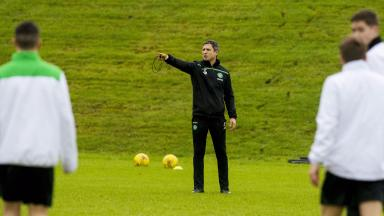 The assistant manager watches over his squad in training.