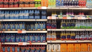 A sugary drink tax could cut the number of obese people according to a new report.