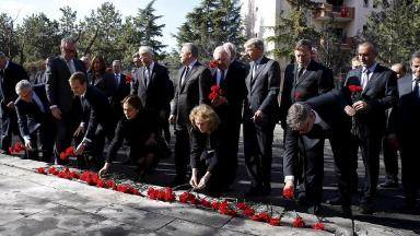 Ambassadors place carnations as they visit the site of the suicide bomb attack in Ankara.