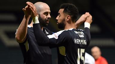 Gary Harkins celebrates with Kane Hemmings.