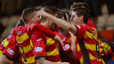 Partick Thistle celebrate a home win against St Johnstone.