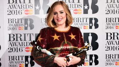 Adele with two of her four awards