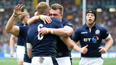 Scotland's John Barclay (6) celebrates his try with his team-mates