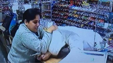 The woman bravely fought off the armed robber.