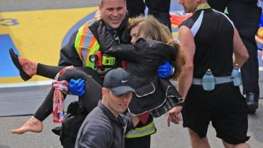 The photo of Victoria McGrath being carried to safety by a Boston firefighter became one of the defining images from the 2013 marathon atrocity.