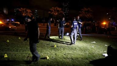 Israeli police search the spot where the stabbings took place