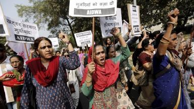 Activists in New Delhi protest against the treatment of women.
