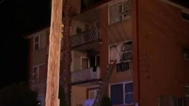 The woman threw her children to neighbours below in a bid to save them from the fire