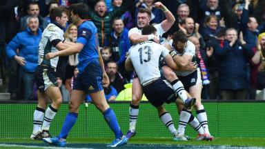 Scotland's Stuart Hogg celebrates after his team-mate Duncan Taylor (13) scores a try