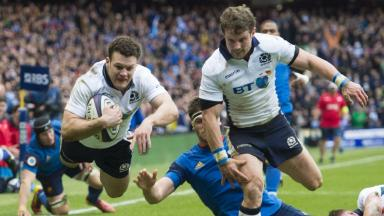 Roar: Duncan Taylor finishes a thrilling break to extend Scotland's lead