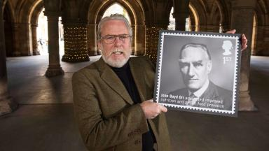 Honoured: Andrew Lubbock with the stamp featuring his grandfather.
