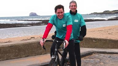 Challenge: Ken Reid, right, pictured with tandem partner Matthew Dollive.